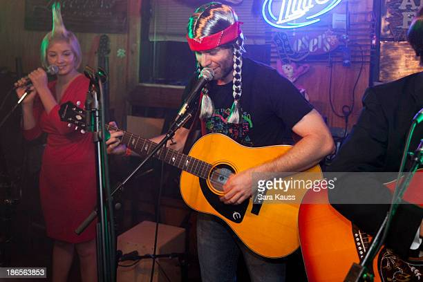 Maggie Rose and Bobby Bones perform at the TJ Martell Foundation's Battle for the Bones for the Linds Sarcoma Fund at Losers Bar Grill on October 31...