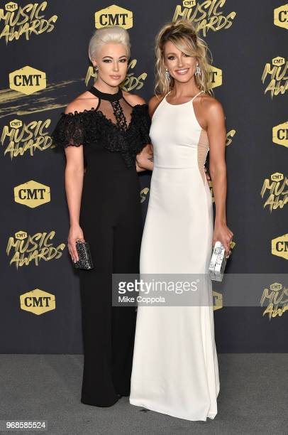 Maggie Rose and Whitney Duncan of musical group Post Monroe attend the 2018 CMT Music Awards at Bridgestone Arena on June 6 2018 in Nashville...