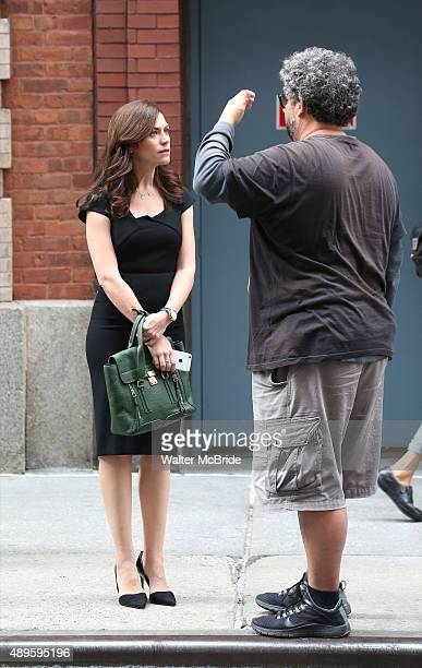 Maggie Siff and director Neil LaBute filming outside the Lyric Theatre on the set of the Showtime series 'Billions' on September 22, 2015 in New York...
