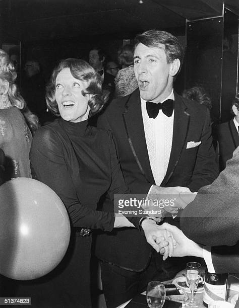 Maggie Smith and her husband Robert Stephens lead the singing of 'Auld Lang Syne' at a New Year's Eve party 1st January 1973
