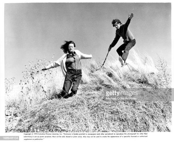 Maggie Smith and Timothy Bottoms fall down a hill in a scene from the film 'Love And Pain And The Whole Damn Thing' 1973
