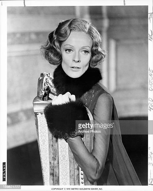 Maggie Smith leaning up on chair in a scene from the film 'Travels With My Aunt' 1972