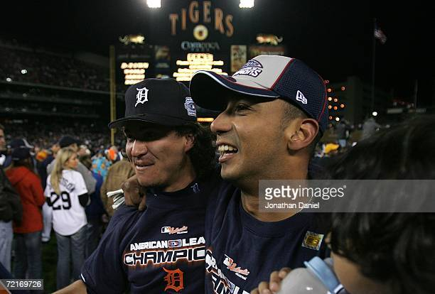 Magglio Ordonez and Carlos Guillen of the Detroit Tigers celebrate on the field after the Tigers won 63 against the Oakland Athletics during Game...