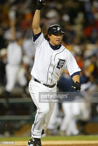 Magglio Ordonez of the Detroit Tigers celebrates after hitting a threerun home run to win Game Four of the American League Championship Series...