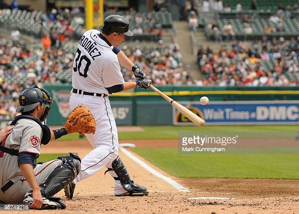 Magglio Ordonez of the Detroit Tigers gets his 2000 career hit in the fourth inning a single off of Carl Pavano of the Minnesota Twins at Comerica...