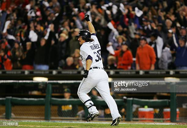 Magglio Ordonez of the Detroit Tigers hits a three run home run against the Oakland Athletics to win Game Four of the American League Championship...