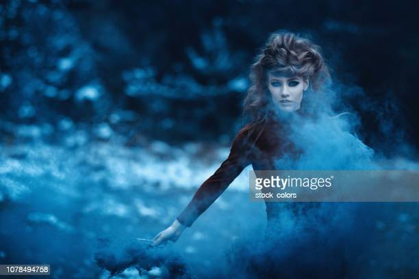 magic blue smoke - fairy stock photos and pictures