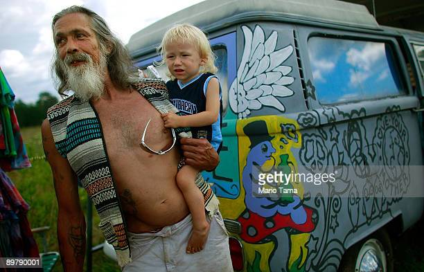 Magic holds his son Jacob Magic Pharis as the 40th anniversary of the Woodstock music festival approaches August 14 2009 in Bethel New York On August...