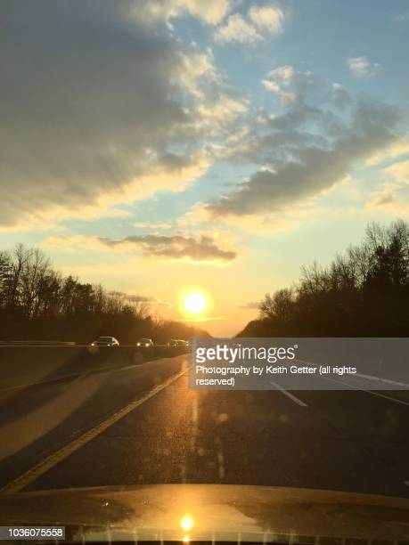magic hour: driving on a highway into the sunset - new jersey turnpike stock photos and pictures