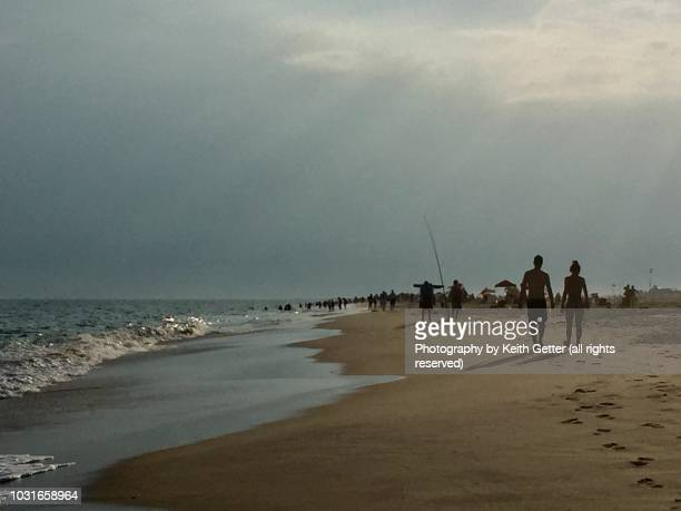 magic hour: sunbeams at sunset at an ocean beach - wantagh stock pictures, royalty-free photos & images