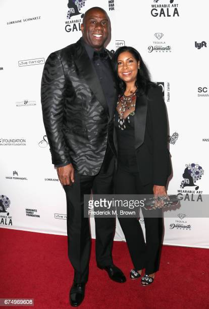 Magic Johnson and Cookie Johnson attend the Wearable Art Gala at California African American Museum on April 29 2017 in Los Angeles California