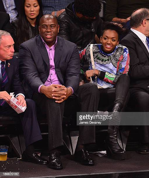 Magic Johnson and daughter Elisa attend the Miami Heat vs Brooklyn Nets game at Barclays Center on November 1 2013 in the Brooklyn borough of New...