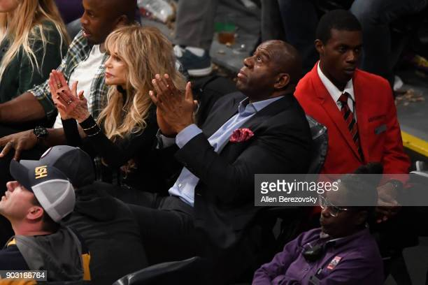 Magic Johnson and Dyan Cannon attend a basketball game between the Los Angeles Lakers and the Sacramento Kings at Staples Center on January 9 2018 in...