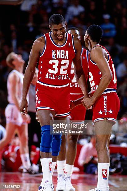 Magic Johnson and Fat Lever of the Western Conference AllStars talk during the 1988 NBA AllStar Game on February 7 1988 at the Chicago Stadium in...