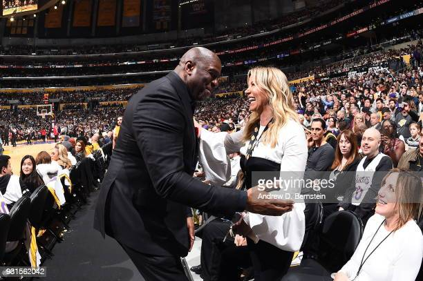 Magic Johnson and Jeanie Buss exchange a hug during the game between the Los Angeles Lakers and Cleveland Cavaliers on March 11 2018 at STAPLES...