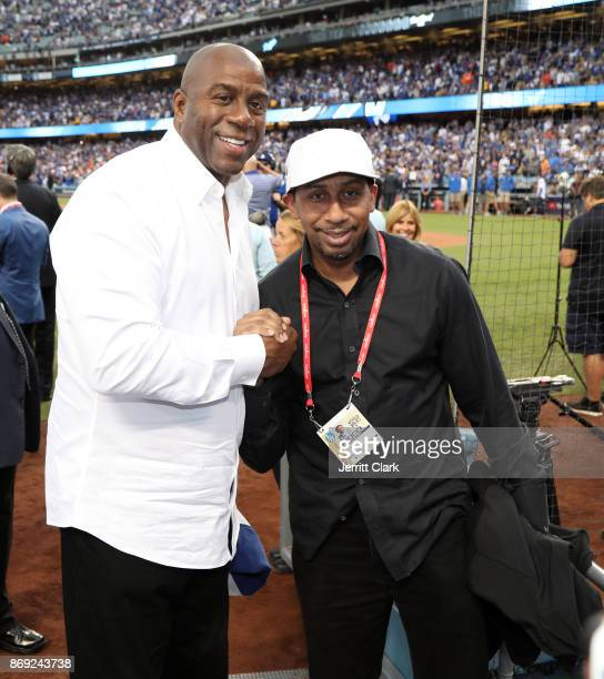 Magic Johnson and Stephen A Smith attend The 2017 World Series Game 7 at Dodger Stadium on November 1 2017 in Los Angeles California
