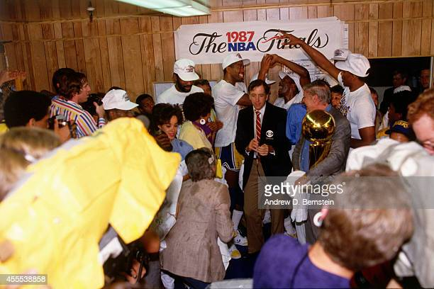 Magic Johnson and teammates of the Los Angeles Lakers celebrate after winning Game Six of the 1987 NBA Finals on June 14 1987 at the Great Western...