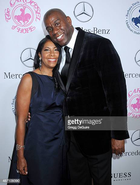 Magic Johnson and wife Cookie Johnson arrive at the 2014 Carousel Of Hope Ball Presented By MercedesBenz at The Beverly Hilton Hotel on October 11...