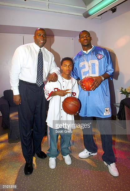 Magic Johnson Bow Wow and LeBron James pose for a photo backstage during MTV's Total Request Live June 18 2003 at the MTV Times Square Studios in New...