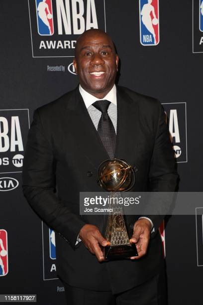 Magic Johnson, co-recipient of the Lifetime Achievement Award, poses in the press room during the 2019 NBA Awards presented by Kia on TNT at Barker...
