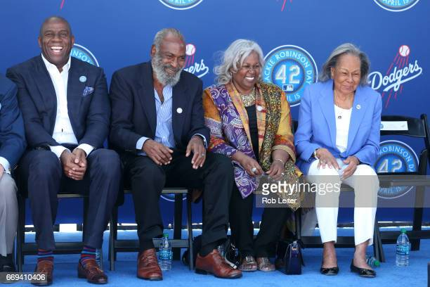 Magic Johnson David Robinson Sharon Robinson and Rachel Robinson smile at the unveiling of the Jackie Robinson statue before the game between the...
