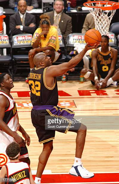 Magic Johnson drives to the basket during the Jeep All-Star Hoop-It-Up during the 2003 NBA All-Star Weekend on February 8, 2003 at Philips Arena in...