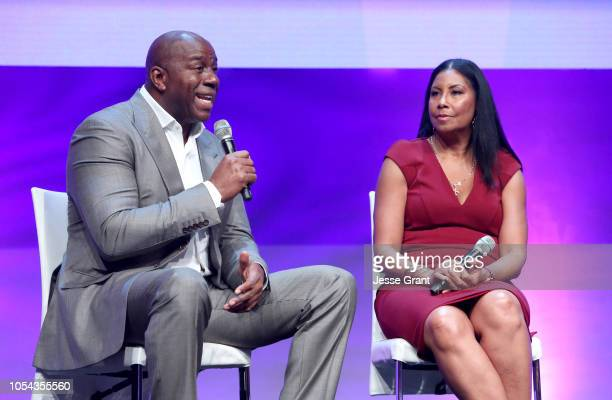 Magic Johnson Enterprises Chairman and CEO Magic Johnson and Entreprenuer Author Cookie Johnson speak onstage at the SUPERCHARGED Summit By Kwanza...