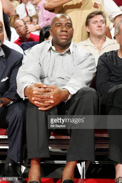Magic Johnson former Los Angeles Laker great sits courtside during the game between the Dallas Mavericks and the Houston Rockets in Game three of the...
