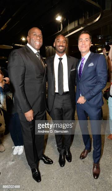 Magic Johnson Kobe Bryant and Rob Pelinka pose for a photo before the game between the Golden State Warriors and the Los Angeles Lakers on December...