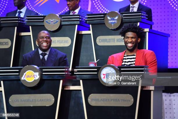 Magic Johnson of the Los Angeles Lakers and Joel Embiid of the Philadelphia 76ers laugh during the 2017 NBA Draft Lottery at the New York Hilton in...