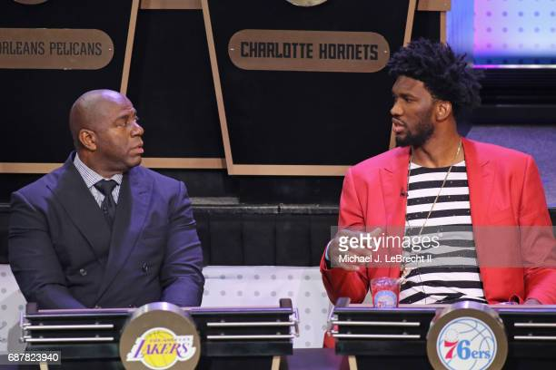 Magic Johnson of the Los Angeles Lakers and Joel Embiid of the Philadelphia 76ers talk during the 2017 NBA Draft Lottery at the New York Hilton in...