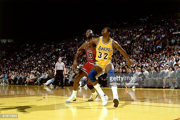 Magic Johnson of the Los Angeles Lakers battles for position with Michael Jordan of the Chicago Bulls during the NBA game at the Forum in Los Angeles...