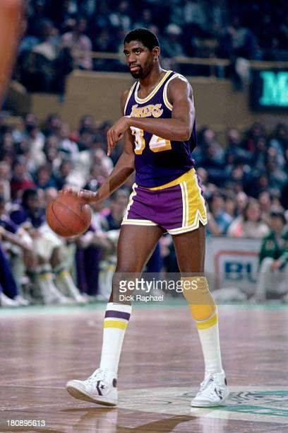 Magic Johnson of the Los Angeles Lakers calls out a play during a game circa 1984 at the Boston Garden in Boston Massachusetts NOTE TO USER User...
