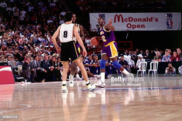 Magic Johnson of the Los Angeles Lakers calls out play against Badalona during the 1991 McDonald's Open circa 1991 in Limoges France NOTE TO USER...
