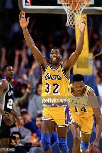 Magic Johnson of the Los Angeles Lakers celebrates a big play against the San Antonio Spurs during a 1990 NBA game played at the Great Western Forum...
