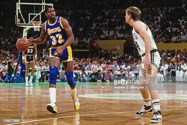 Magic Johnson of the Los Angeles Lakers dribbles against Danny Ainge of the Boston Celtics during the 1987 NBA Finals circa 1987 at the Boston Garden...