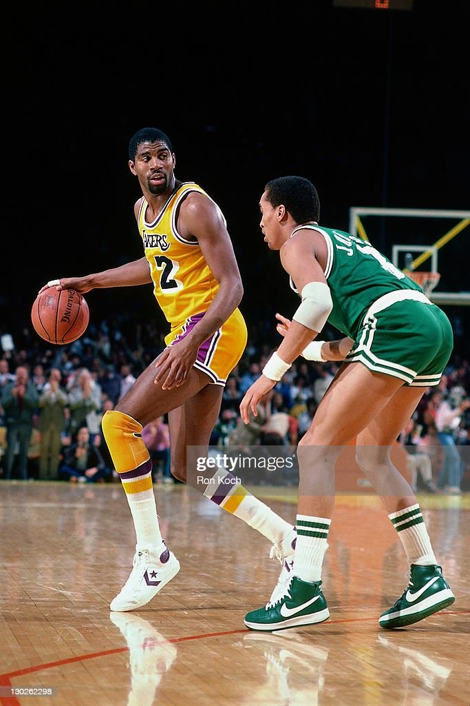 Magic Johnson of the Los Angeles Lakers dribbles against ...
