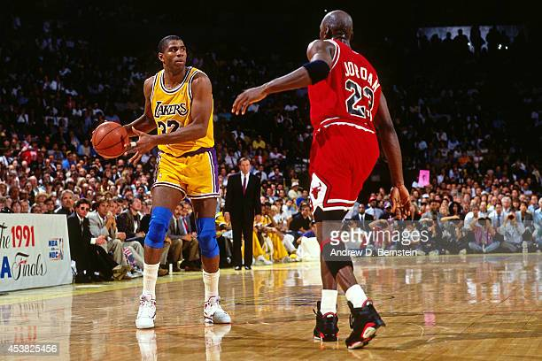 Magic Johnson of the Los Angeles Lakers dribbles against Michael Jordan of the Chicago Bulls during Game Three of the 1991 NBA Finals on June 7 1991...