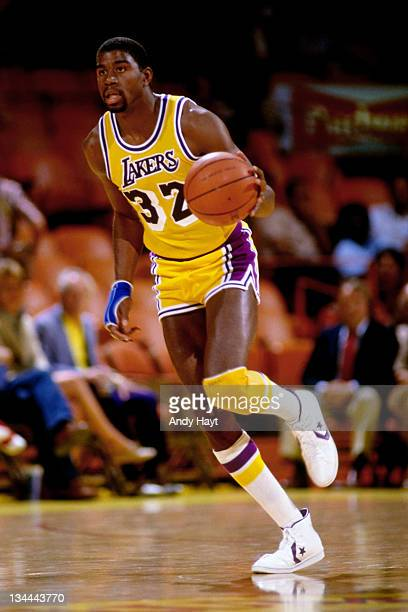 Magic Johnson of the Los Angeles Lakers dribbles circa 1985 at the Great Western Forum in Inglewood California NOTE TO USER User expressly...
