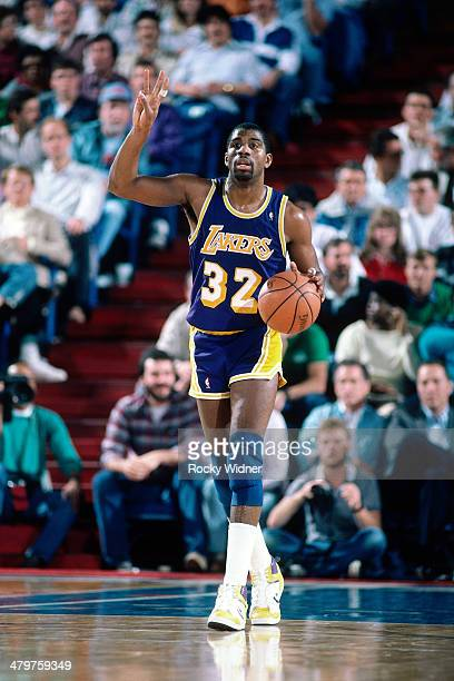 Magic Johnson of the Los Angeles Lakers dribbles during a game played circa 1987 at Arco Arena in Sacramento, California. NOTE TO USER: User...
