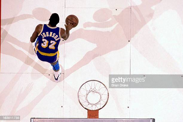 Magic Johnson of the Los Angeles Lakers dribbles the ball against the Portland Trail Blazers during a game played circa 1989 at the Veterans Memorial...