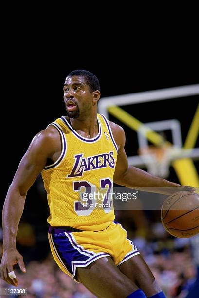 Magic Johnson of the Los Angeles Lakers dribbles the ball during an NBA game at the Great Western Forum in Los Angeles California in 1987