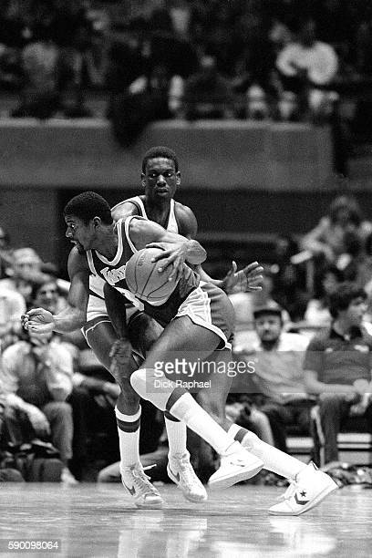 Magic Johnson of the Los Angeles Lakers dribbles the ball while defended by Albert King of the New Jersey Nets at Brendan Byrne Arena in East...