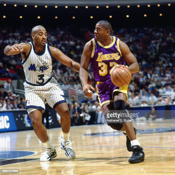 Magic Johnson of the Los Angeles Lakers drives during a game played on March 26 1996 at Orlando Arena in Orlando Florida NOTE TO USER User expressly...