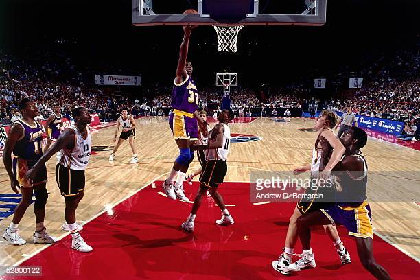 Magic Johnson of the Los Angeles Lakers drives for a layup against Badalona during the 1991 McDonald's Open circa 1991 in Limoges France NOTE TO USER...
