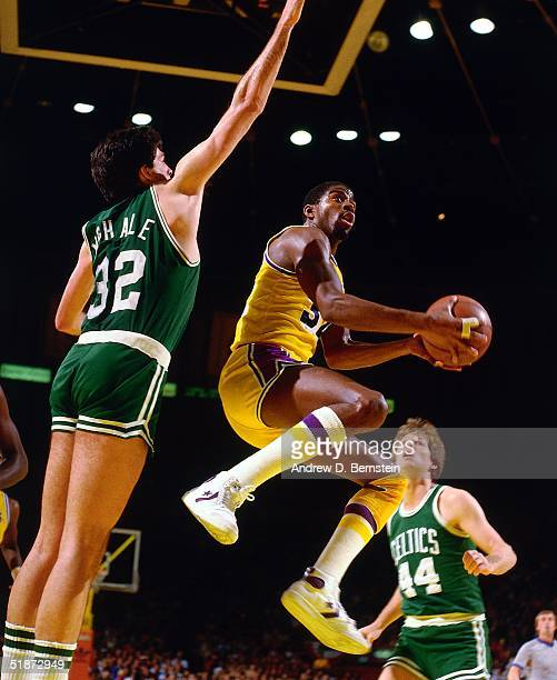 Magic Johnson of the Los Angeles Lakers drives to the basket against Kevin McHale of the Boston Celtics during an NBA game at the Forum in Los...