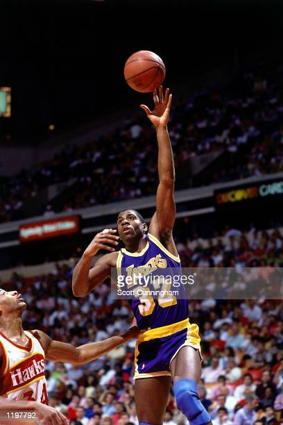 Magic Johnson of the Los Angeles Lakers goes for a hookshot against the Atlanta Hawks in the 1986 season during the NBA game in Atlanta Georgia NOTE...