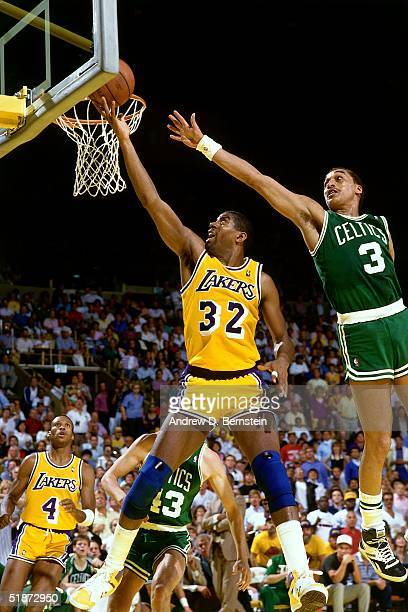 Magic Johnson of the Los Angeles Lakers goes for a layup against the Boston Celtics during the NBA game at the Forum in Los Angeles California NOTE...