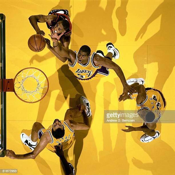 Magic Johnson of the Los Angeles Lakers goes for a layup against the Miami Heat during the NBA game at the Forum in Los Angeles, California. NOTE TO...