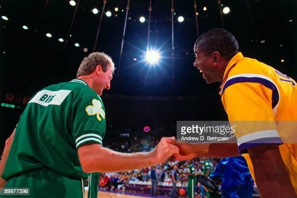 Magic Johnson of the Los Angeles Lakers greets Larry Bird of the Boston Celtics prior to the games during the 1991 NBA season at The Great Western...